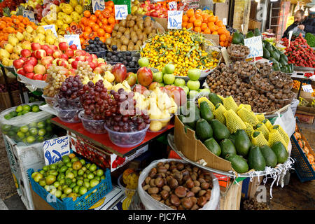 Islamic Republic of Iran. Tehran Bazaar. Household items or edibles for sale. Fruits and vegetables. - Stock Photo