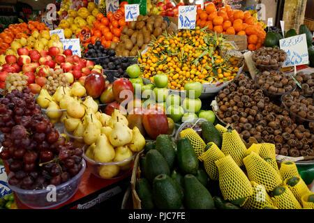 Islamic Republic of Iran. Tehran Bazaar. Edibles for sale. Fruits and vegetables. - Stock Photo