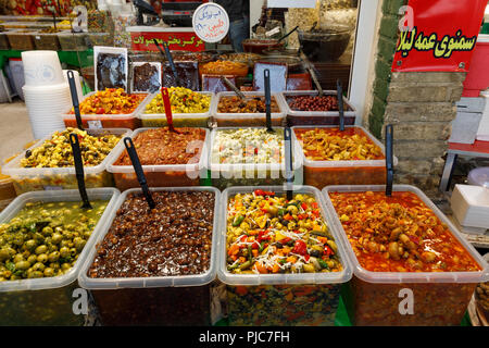 Islamic Republic of Iran. Tehran Bazaar. Household items or pickled edibles for sale. - Stock Photo