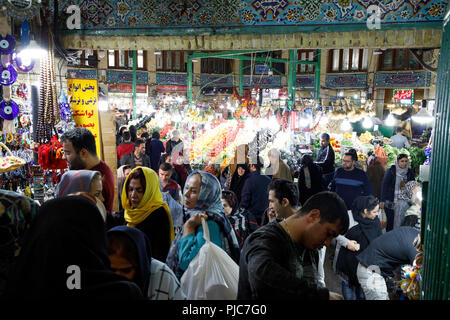 Islamic Republic of Iran. Tehran Bazaar. Household items or edibles for sale. - Stock Photo