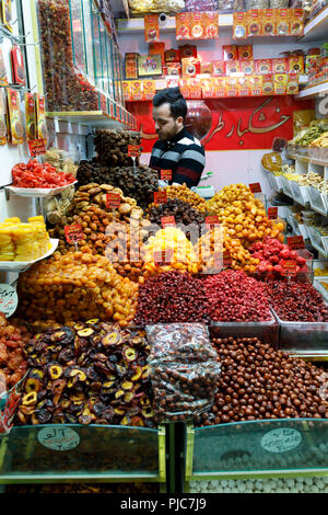 Islamic Republic of Iran. Tehran Bazaar. Household dried fruits and saffron edibles for sale. - Stock Photo