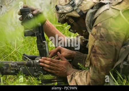 U.S. Army Paratroopers assigned to the 82nd Airborne Division reloads 240 Bravo at Fort Bragg, North Carolina, July 17, 2018. The 82nd Airborne Division conducted this Deployment Readiness Excercise to assess and develop rapid response times torward real world scenarios. ( U.S. Army - Stock Photo