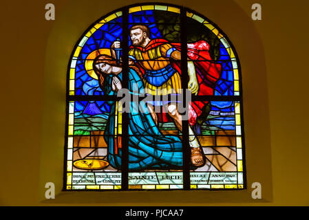 Stained glass window at the Chicken Church (Da Lat Cathedral), Da Lat, Vietnam. - Stock Photo