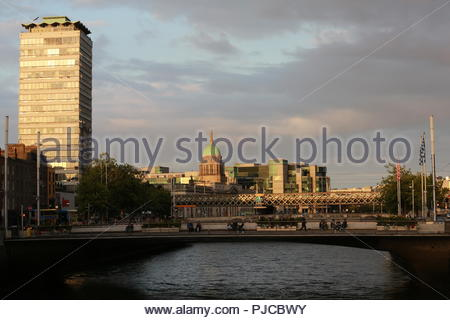 A view of the River Liffey in Dublin at sundown on a beautiful summer's evening as tourist figures continue to climb in the city. - Stock Photo