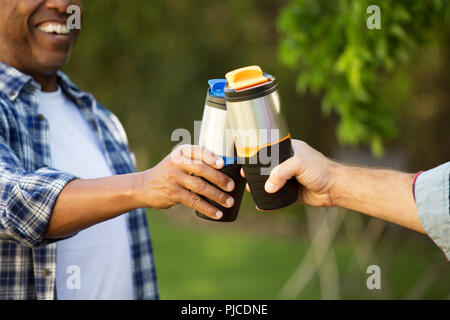 Diverse group of friends talking and laughing. - Stock Photo