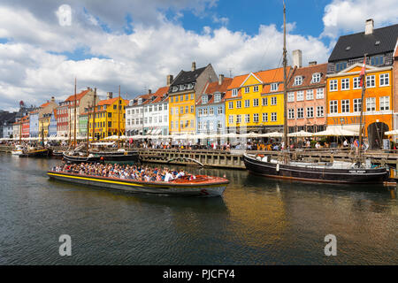 Nyhavn (New Harbour) is a 17th-century waterfront, canal and entertainment district in Copenhagen, Denmark. - Stock Photo