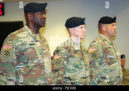Col. Oscar W. Doward Jr., outgoing commander of the 2503rd Digital Liaison Detachment, Maj. Gen. David C. Hill, deputy commanding general, U.S. Army Central, and Col. Douglas W. Mills, incoming commander of the 2503rd DLD, stand at attention during a change-of-command ceremony July 19, 2018, at Patton Hall on Shaw Air Force Base, S.C. - Stock Photo