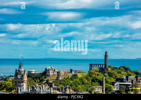 Edinburgh old city centre panoramic view of architecture from vantage point of Edinburgh Castle featuring Waverley railway station and Calton hill - Stock Photo