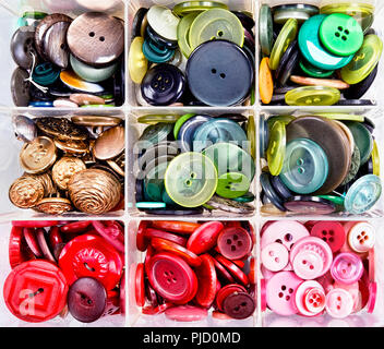 A variety of colourful buttons in bins. - Stock Photo