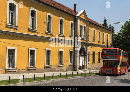 SKOPJE, REPUBLIC OF MACEDONIA - 13 MAY 2017:  A red double-decker bus passing through the streets of city of Skopje, Republic of Macedonia - Stock Photo