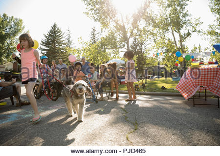 Kids and dog parade at summer neighborhood block party in sunny park - Stock Photo
