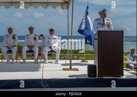 ASAN BEACH, Guam (July 19, 2018) Rear Adm. Troy McClelland, Deputy Commander for the Naval Construction Force, Navy Expeditionary Command, speaks during 30th Naval Construction Regiment's (30 NCR) change of command ceremony at the War in the Pacific National Historical Park Asan Beach Unit. During the ceremony, Capt. Steven Stasick relieved Capt. Jeffrey Kilian as commodore of 30 NCR. - Stock Photo