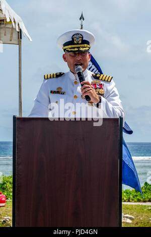 ASAN BEACH, Guam (July 19, 2018) Capt. Jeffrey Kilian, commodore of 30th Naval Construction Regiment (30 NCR), speaks during 30 NCR's change of command ceremony at the War in the Pacific National Historical Park Asan Beach Unit. During the ceremony, Capt. Steven Stasick relieved Kilian as commodore of 30 NCR. - Stock Photo