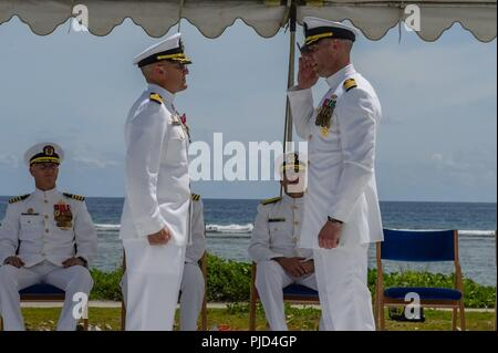 ASAN BEACH, Guam (July 19, 2018) Capt. Steven Stasick (left) relieves Capt. Jeffrey Kilian as commodore of the 30th Naval Construction Regiment during a change of command ceremony at the War in the Pacific National Historical Park Asan Beach Unit. - Stock Photo