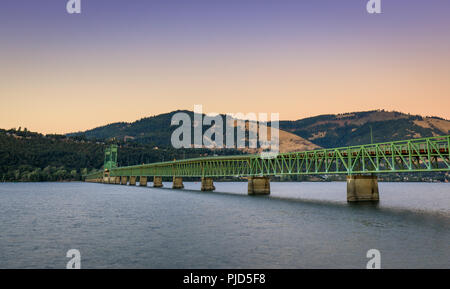 The green truss Hood River Bridge that crosses the Columbia River Gorge and connects Hood River in Oregon - Stock Photo