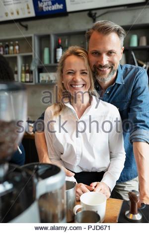 Portrait happy cafe owner couple - Stock Photo