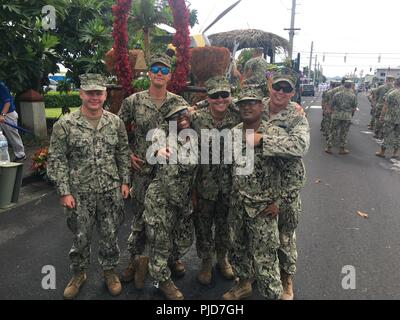 SANTA RITA, Guam (July 21st, 2018) Seabees, assigned to Naval Mobile Construction Battalion Eleven (NMCB) 11, Detachment Guam, pose for a photo during the Liberation Day Parade. NMCB-11 is forward deployed to execute construction, humanitarian and foreign assistance, and theater security cooperation in the 7th Fleet area of operations. - Stock Photo