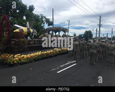SANTA RITA, Guam (July 21st, 2018) Sailors from various commands on Naval Base Guam walk in the Liberation Day Parade, next to the Seabee parade float. - Stock Photo