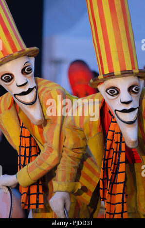 Saint Petersburg,Russia - August 4,2018: VIII International festival of street theatres 'Elagin Park'. Mr Pejo`s Wandering Dolls. Two jolly jokers in  - Stock Photo