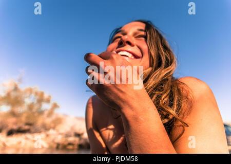 Woman relaxing in camp area, Bishop, California, USA - Stock Photo