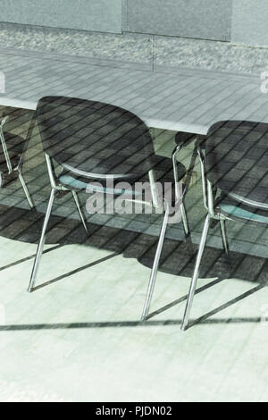 Office chairs inside with outdoor reflection from the bright exterior. - Stock Photo