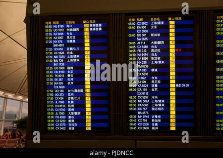 departure board terminal 1 hong kong international airport chek lap kok hong kong china - Stock Photo