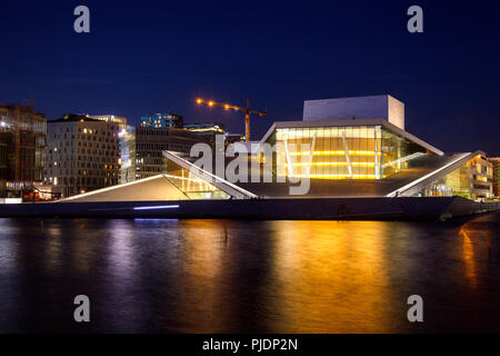 OSLO, NORWAY - JULY 24, 2018: Oslo Opera House (Operahuset),  home of The Norwegian National Opera and Ballet and the national opera theatre with Barc - Stock Photo