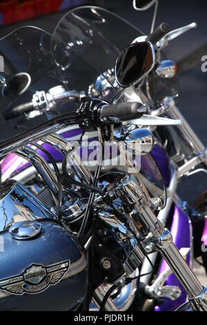 Harley-Davidson motorbikes parked in a street - Stock Photo