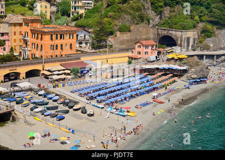 Italy, Liguria, Cinque Terre, Monterosso al Mare,  Vista of the Old Town with sandy beach in the foreground. - Stock Photo