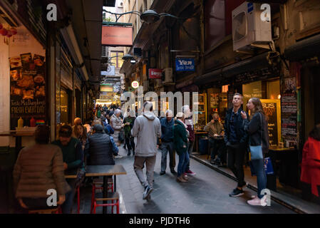 Degraves Street in Melbourne, Australia, the laneway full of cafe, restaurants, shops, and tourists - Stock Photo