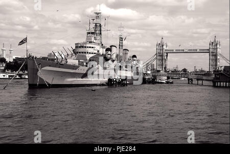 HMS Belfast, the WW2 light Cruiser at anchor in the Pool of London. Next to Tower bridge on the south bank of the Thames in the Pool of London - Stock Photo