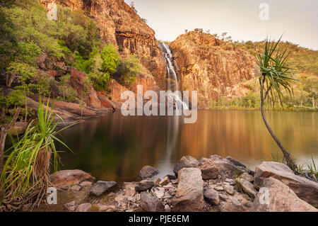 Gunlom Falls and their picturesque waterhole. - Stock Photo