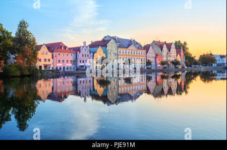 Landshut Old Town, Bavaria, Germany, traditional colorful gothic houses reflecting in Isar river on sunrise - Stock Photo