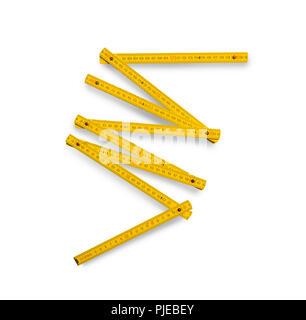 Folding rule measuring tool isolated on white background - Stock Photo