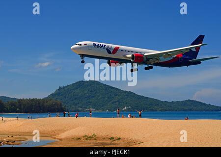 Airplane of the society azure air in the land flight, May Kao Beach, Phuket, Thailand, Flugzeug der Gesellschaft Azur Air im Landeanflug, Mai Kao Beac - Stock Photo