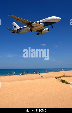 Airplane of the society of Bangkok air in the land flight, May Kao Beach, Phuket, Thailand, Flugzeug der Gesellschaft Bangkok Air  im Landeanflug, Mai - Stock Photo
