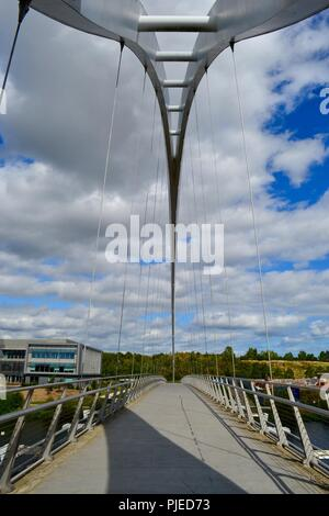 Striking, naturally lit image of the iconic Infinity Bridge spanning the River Tees in Stockton-on-Tees, UK. Stock Photo