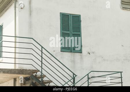 Isolated green wondow of a white house (Pesaro, Italy, Europe) - Stock Photo
