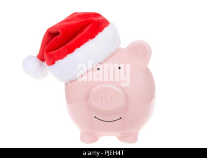 Pink piggy bank wearing a Santa hat smiling facing viewer isolated on white. - Stock Photo