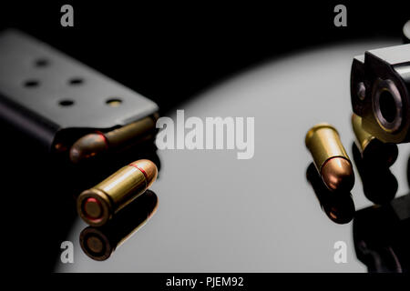 Bullet shells, barrel of a gun and magazine cartridge close up. Hand Gun and Ammunition. Mental health and violence concept. Fully loaded. - Stock Photo