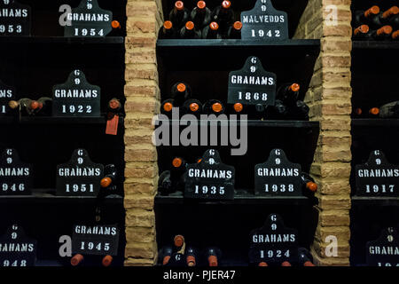Graham's Port Lodge, Vila Nova de Gaia, Porto, Portugal, showing bottles of port from the year 1868. - Stock Photo