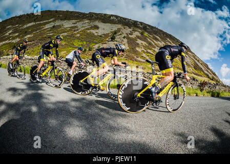 Whinlatter, Cumbria, UK. 6th September 2018. Team Direct Energie catch a local rider out whilst warming up for stage 5 of the Tour of Britain, Whinlatter Pass, Cumbria. Credit: STEPHEN FLEMING/Alamy Live News - Stock Photo
