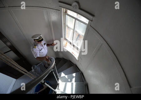 Hillsboro Beach, FL, USA. 6th Sep, 2018. Hillsboro Inlet Lighthouse Preservation Society executive director Art Makenian climbs the steps of the Hillsboro Lighthouse in Hillsboro Beach on Thursday, Sept. 6, 2018. The Hillsboro Lighthouse Preservation Society has just completed a historic restoration of Lighthouse entrance and some of the structural fittings. (Amy Beth Bennett/South Florida Sun Sentinel) Credit: Sun-Sentinel/ZUMA Wire/Alamy Live News - Stock Photo