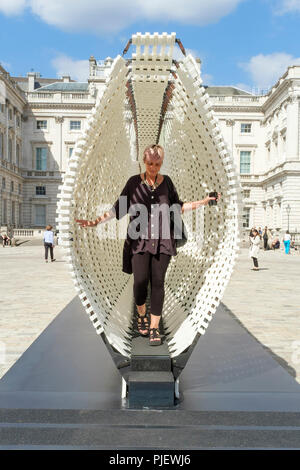 London, UK. 6th September 2018. International design teams from 40 countries are exhibiting interactive design installations on the theme of Emotional States  at Somerset House during the London Design Biennale 2018. The exhibition runs from 4-23 September. Pictured: Disobedience (Greece) A 17 metre-long wall made from a steel spring skeleton and recycled plastic. As visitors step inside the dynamic wall flexes and morphs with their movements. Credit: mark phillips/Alamy Live News - Stock Photo
