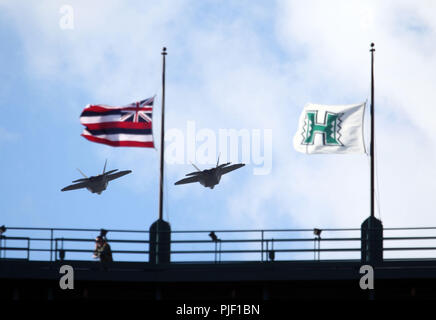 September 1, 2018 - F-22 Raptors do a fly over prior to a during a game between the Hawaii Rainbow Warriors and the Navy Midshipmen at Aloha Stadium in Honolulu, HI - Michael Sullivan/CSM - Stock Photo