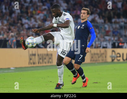 (180907) -- MUNICH, Sept. 7, 2018 (Xinhua) Germany's Antonio Ruediger (L) vies with France's Antoine Griezmann during the UEFA Nations League football match between Germany and France, in Munich, Gremany, on Sept. 6, 2018. The match ended in a 0-0 draw. (Xinhua/Philippe Ruiz) - Stock Photo
