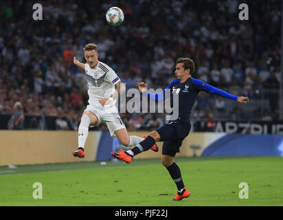 (180907) -- MUNICH, Sept. 7, 2018 (Xinhua) Germany's Marco Reus (L) vies with France's Antoine Griezmann during the UEFA Nations League football match between Germany and France, in Munich, Gremany, on Sept. 6, 2018. The match ended in a 0-0 draw. (Xinhua/Philippe Ruiz) - Stock Photo