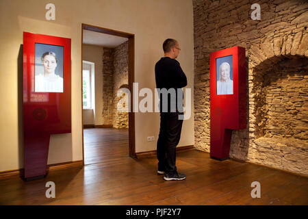 Mansfeld, Germany. 30th Aug, 2018. Museum educator Nick Schoene views a presentation on a monitor in an exhibition at 'Luther's Parental Home Museum'. The museum in Mansfeld (Mansfeld-Südharz district) is to become better known with a marble competition. (on dpa 'Murmelwettbewerb soll für 'Museum Luthers Elternhaus' advertise' from 07.09.2018) Credit: Johannes Stein/dpa-Zentralbild/dpa/Alamy Live News - Stock Photo