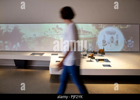 Mansfeld, Germany. 30th Aug, 2018. A woman walks through an exhibition in 'Luther's Parental Home Museum'. The museum in Mansfeld (Mansfeld-Suedharz district) is to become better known with a marble competition. (on dpa 'Murmelwettbewerb soll für 'Museum Luthers Elternhaus' advertise' from 07.09.2018) Credit: Johannes Stein/dpa-Zentralbild/dpa/Alamy Live News - Stock Photo
