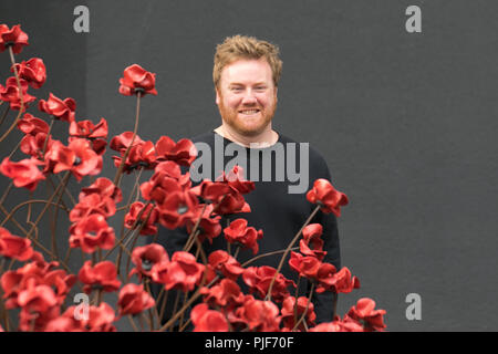 Manchester, UK.7th Sept 2018. The iconic poppy sculpture Wave by artist Paul Cummins and designer Tom Piper at IWM North. This is the final presentation of Wave as part of 14-18 commemoration. It is the first time that Manchester has hosted one of these artworks. The installation 'Blood Swept Lands and Seas of Red' poppies an original concept by artist Paul Cummins.  The installation was originally at HM Tower of London where 888,246 poppies were displayed. Credit: MediaWorldImages/Alamy Live News - Stock Photo